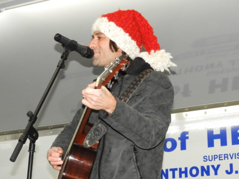 MC Sal Nastasi gets the crowd in a holiday singing mood.