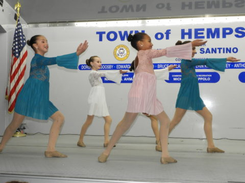 Dancers perform with precision and grace.