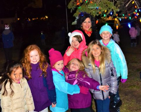 WPOA Vice President RoseAnn Vernice joined several children at the exciting moment when the tree lights went on.